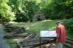 visitor at the historic Iron Furnace