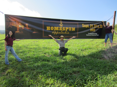 Park Rangers and park partners in front of Homespun Appalachia banner