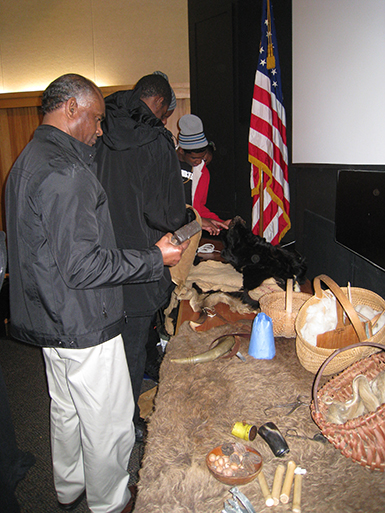 visitors from Barbados looking at exhibit at Cumberland Gap National Historical Park