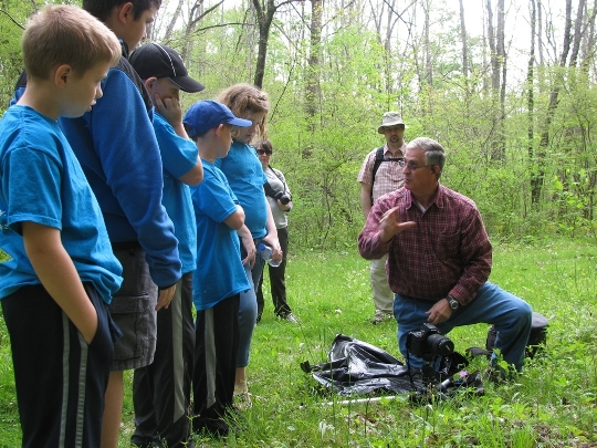 Volunteer Harold Jerrell teaches park visitors about the great outdoors