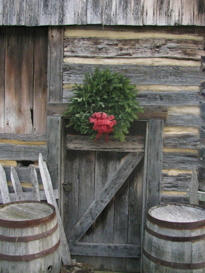 wreath on rustic cabin
