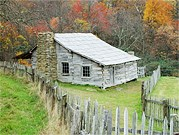 Weathered log cabins greet visitors to Hensley Settlement.