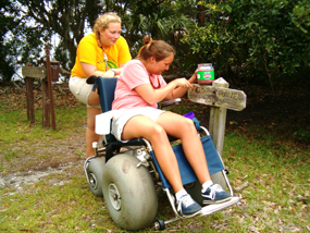 Cumberland Island volunteers assist in the upkeep of painting various trail signs.