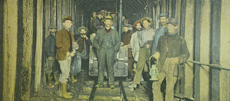 Gunnison tunnel workers with train car.