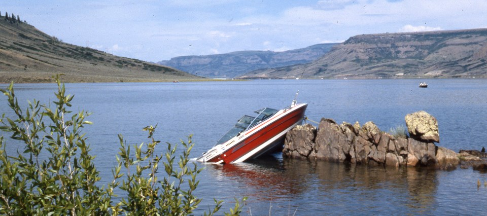 Boat crashed into rocks.