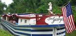 Photo of American Flag on stern of Georgetown canal boat.