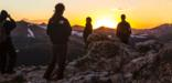 Photo of park visitors enjoying sunset from the Alpine Ridge Trail in Rocky Mountain National Park.