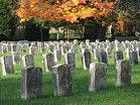 Small image of tombstones and fall foliage at the cemetery