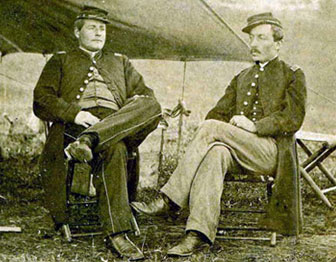Captain Henry C. Newton, 93rd New York and an unidentified Union officer seated in front of a tent.