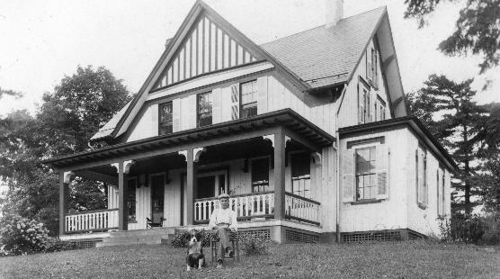Lawson Waterman in front of his farmhouse.