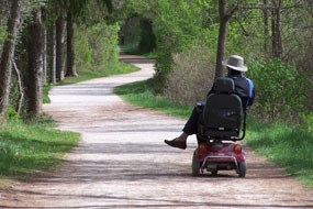 CVNP visitor rides an electric wheelchair along Towpath north of Ira Road.