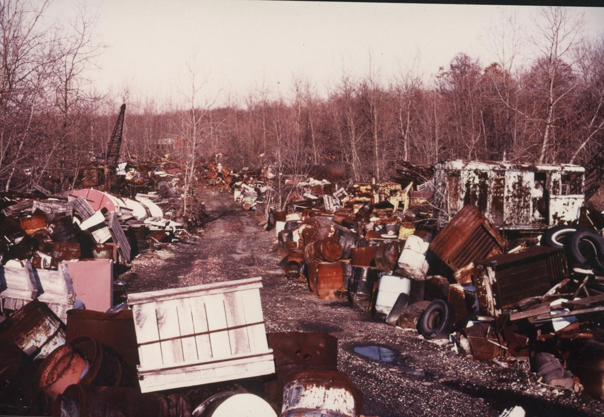 photo of trash and barrels at the old krejic dump