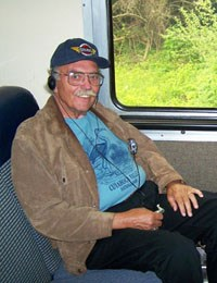 A man rides the Cuyahoga Valley Scenic Railroad train while listening to the fully accessible audio tour.