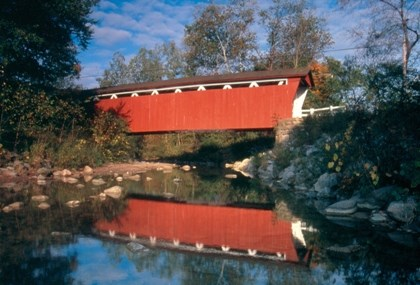 Everett Covered Bridge in summer on a sunny day.  Photo credit: Tom Jones.