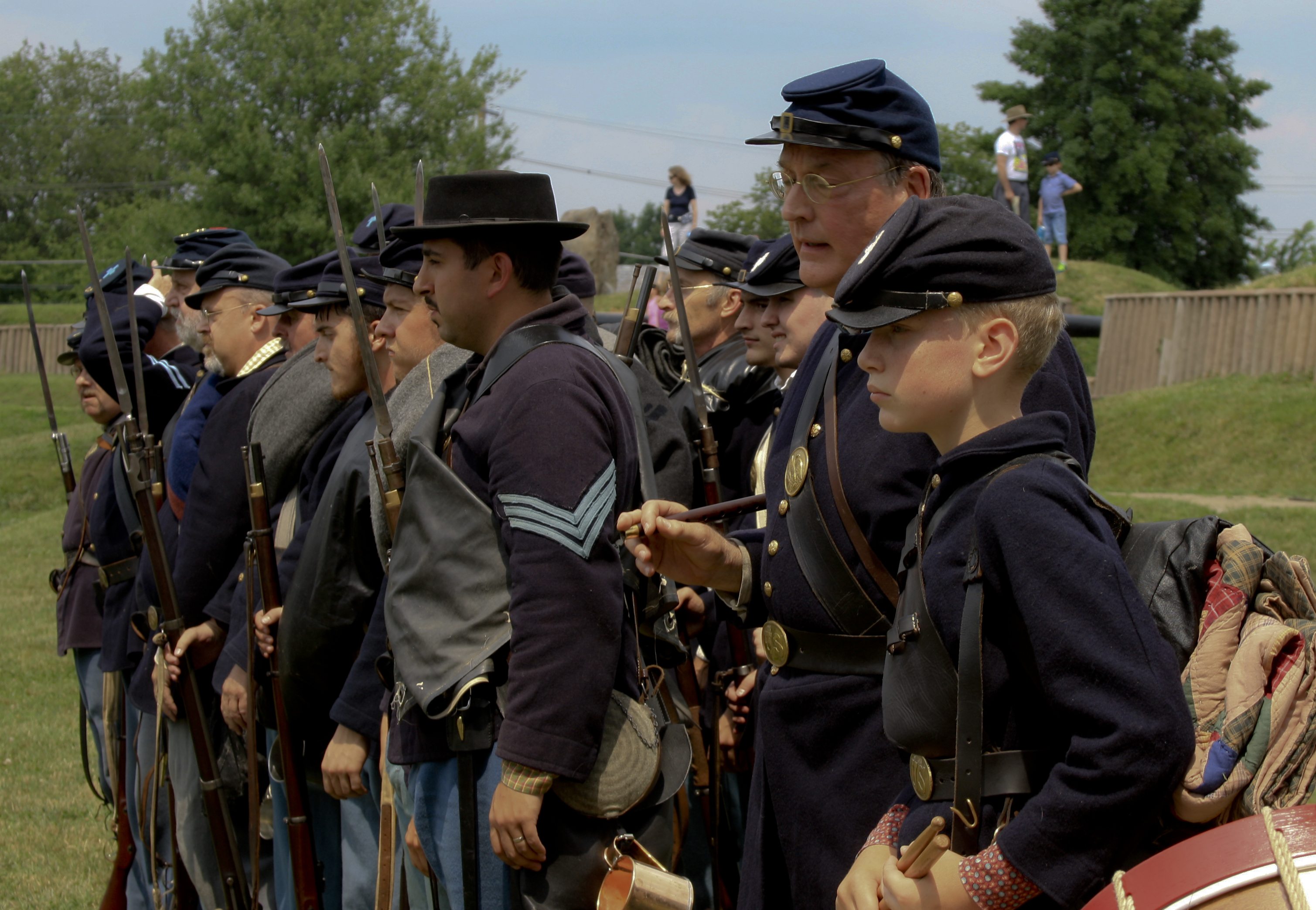 Union soldier re-enactors stand in a row