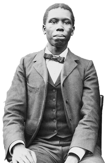 Paul Dunbar sitting, dressed in suit and tie