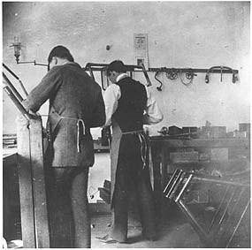 Ed Sines and Orville working in the Wright Cycle Company Shop.