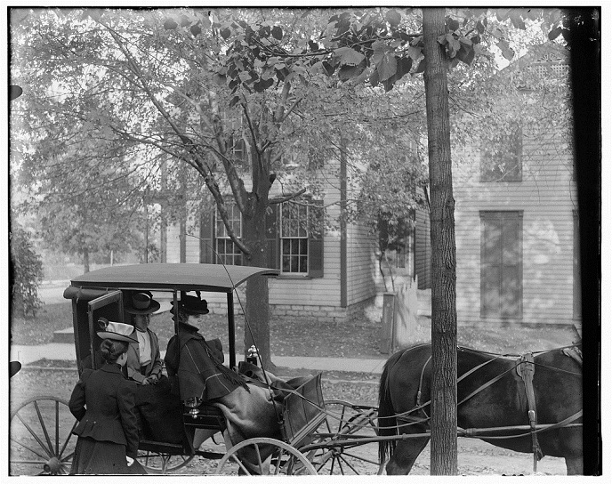Katharine Wright, Harriet Silliman, and Agnes Osborne in horse-drawn carriage across from Wright home, 7 Hawthorn Street, Dayton, Ohio-ca 1899 s