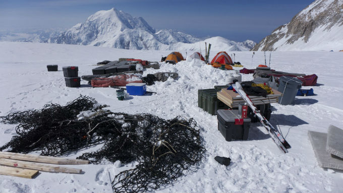 Nets and gear and tents on a glacier