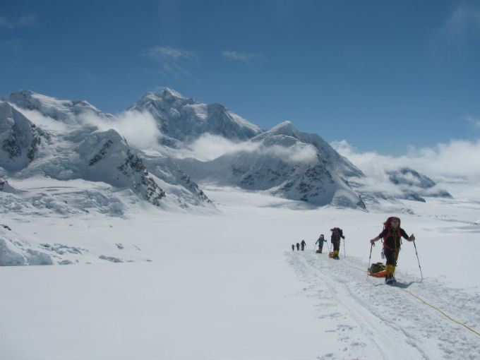 Skiers moving up the glacier at 9,000-feet
