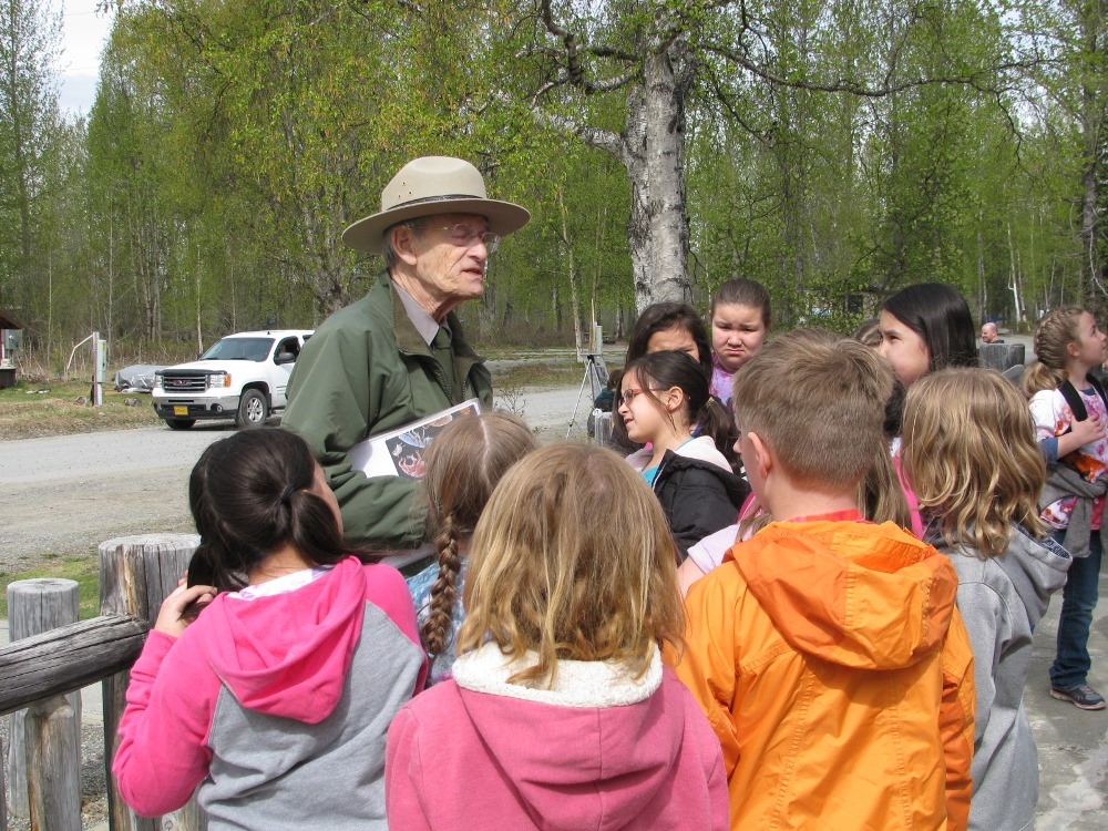 Ranger surrounded by schoolchildren