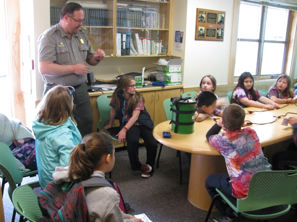 Ranger teaching kids about Leave No Trace practices