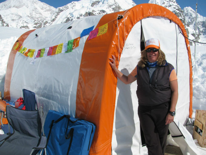 Woman standing in front of colorful tent
