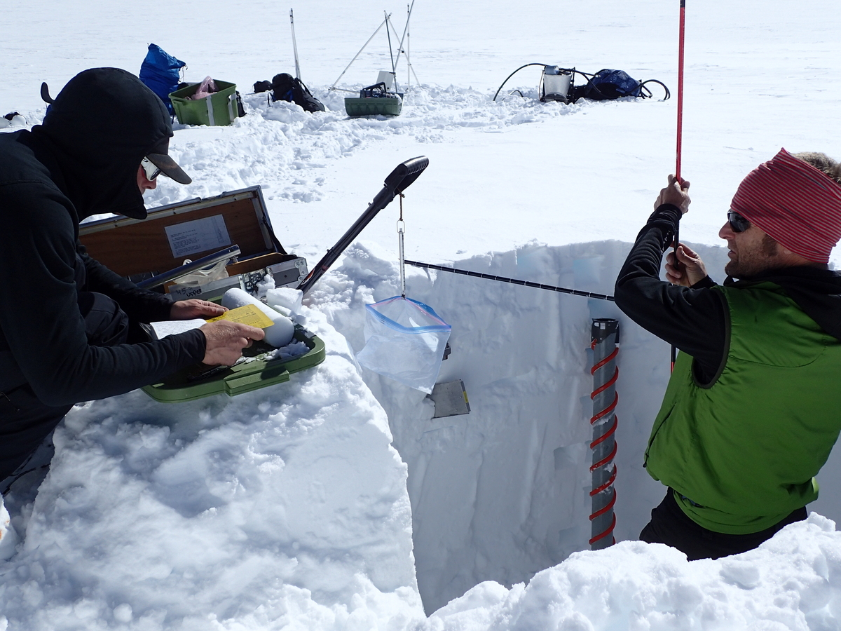Mike Loso installing glacier monitoring equipment at 10,000 feet on the Kahiltna Glacier