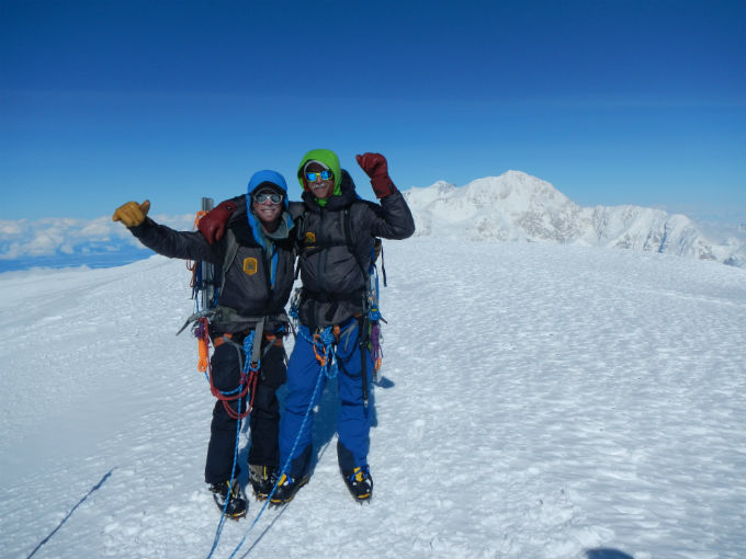 Two climbers on summit of Mount Foraker