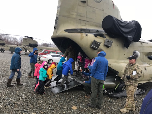 Talkeetna Elementary kids enter the Chinook cargo hold