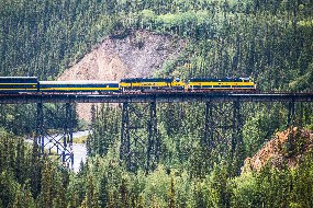 An Alaska Railroad train crosses a trestle above Hines and Riley Creeks