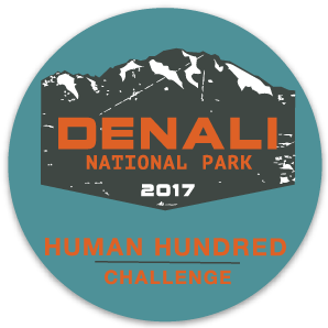 blue circle with a stylized drawing of a mountain and the words denali national park 2017 human hundred challenge