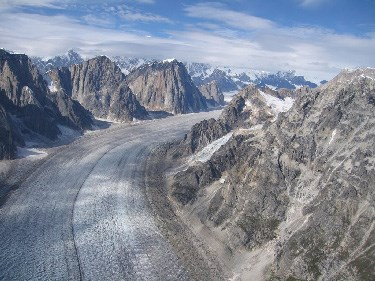 Aerial view of mountains above a river of ice