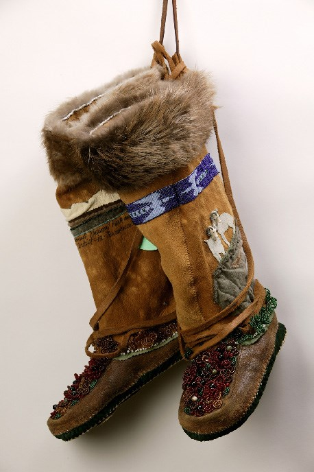 """Walks in the Wilderness: Heart and Sole"" 18"" x 10"" x 11"" skin sewing, beading, found objects, fabric, beaver fur, caribou antler buttons, dog tags"