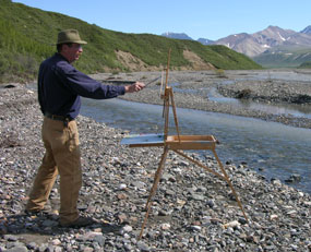 Rod Weagant, artist-in-residence, paints near the East Fork River