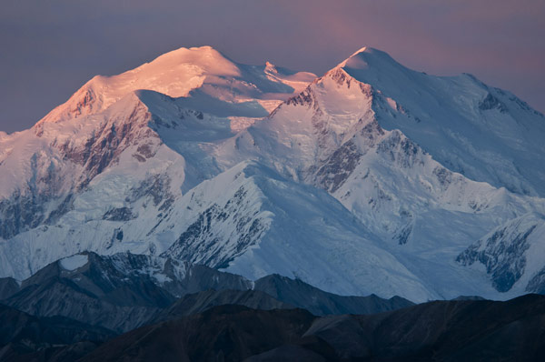 Denali with pink hues due to sunrise