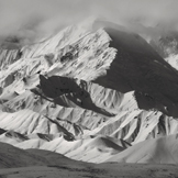 black and white image of a snowy mountain