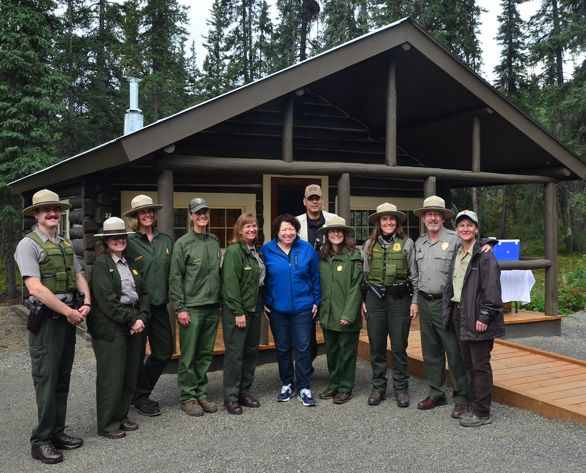 uniformed park rangers posing for a group photo with a supreme court justice