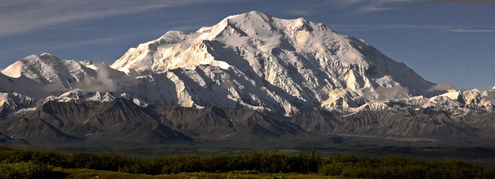 snow covered Denali towers over the surrounding landscape