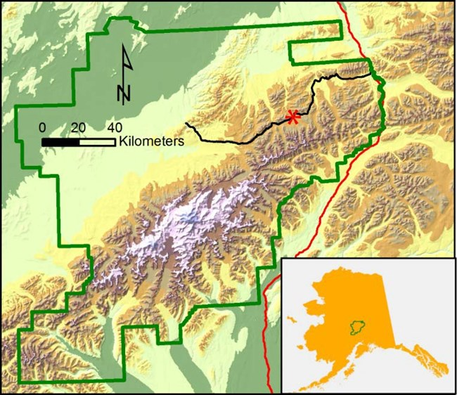 a map of denali illustrating its location in central alaska. a red mark indicates the location of pretty rocks, in roughly the middle of the park's sole road