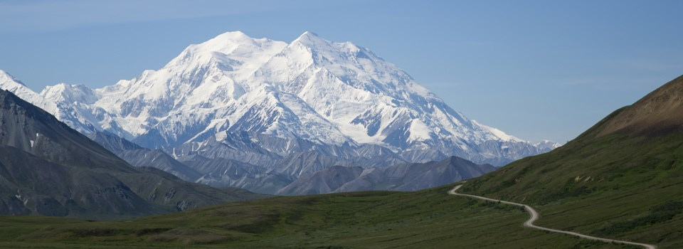 Denali with a dirt road in front of it