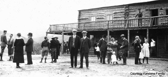 Historic image of people near wood building