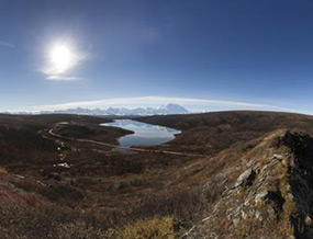 View from hills north of Wonder Lake, with lake in middle ground and Alaska Range in background
