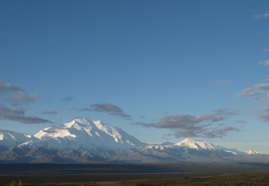 snowy Mount McKinley stands out against a blue sky