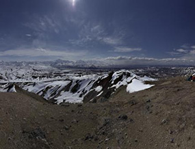 The view from atop Mount Galen, snowy hills and mountains in the distance