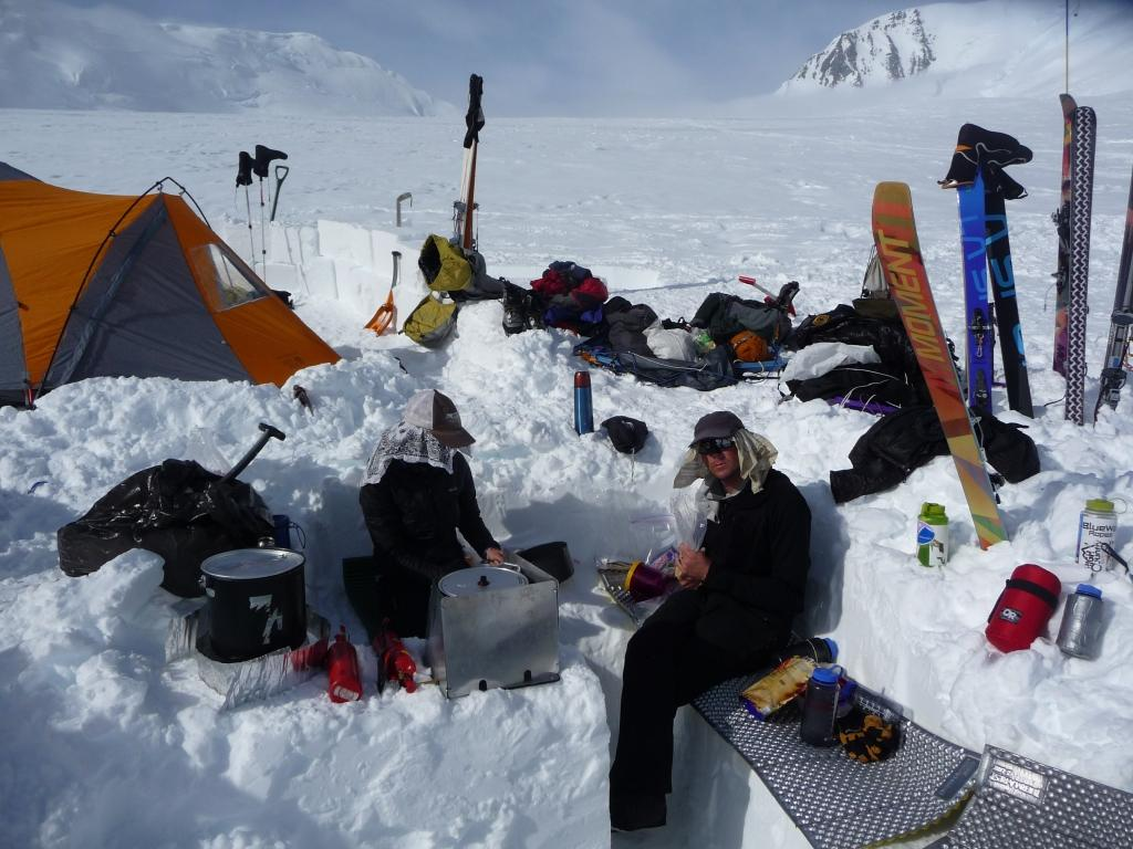 Climbers cooking at a glacier camp