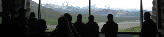 Visitors silhouetted against Eielson window