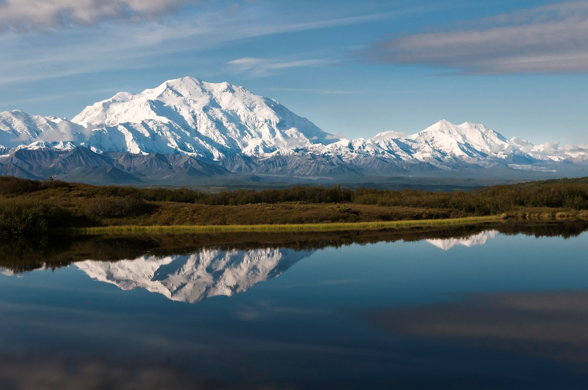 huge snowy mountain reflected in a pond