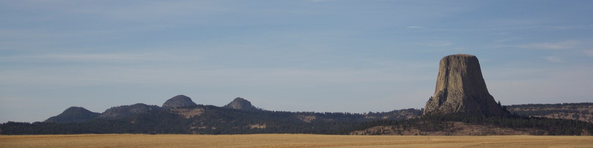 A panoramic view of Devils Tower and the Missouri Buttes from outside the park.