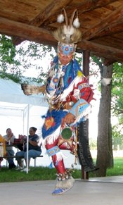 An Arapaho dancer performing a ceremony in traditional regalia